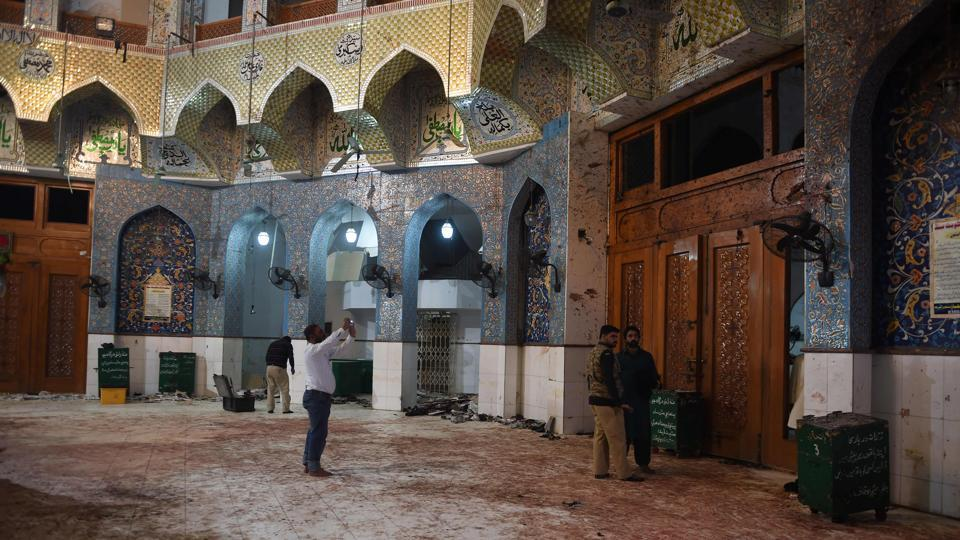Pakistani security officials inspect the blood-stained floor a day after a bomb attack hit the 13th century Muslim Sufi shrine of Lal Shahbaz Qalandar in the town of Sehwan in Sindh province, some 200km northeast of the provincial capital Karachi, on February 17.
