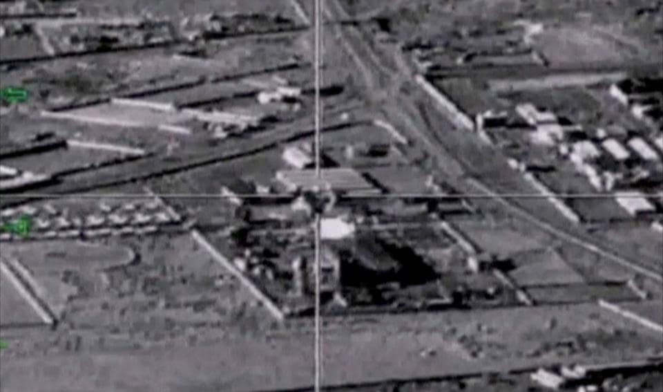 A still image taken from a drone footage and released by Russia's defence ministry shows bombs hitting what the ministry said were Islamic State targets in Deir al-Zor province in Syria.