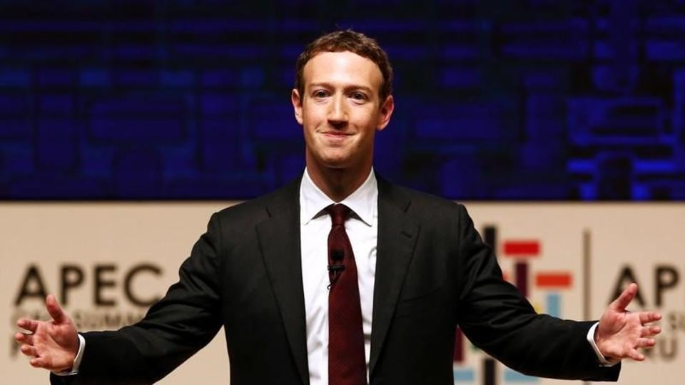 Mark Zuckerberg gestures while addressing the audience.