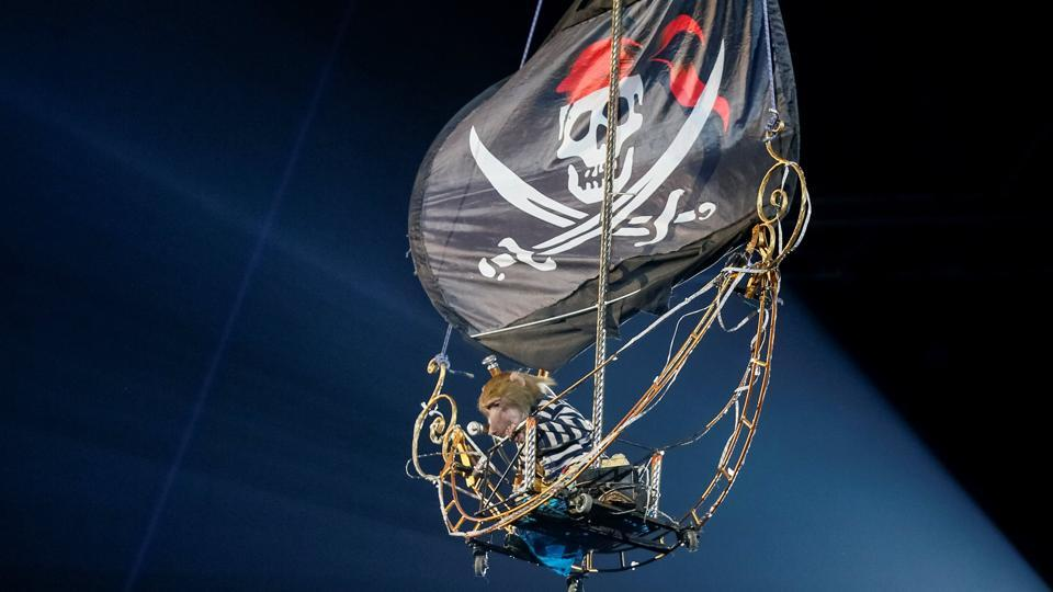 A monkey is raised in a pirate ship replica performs during the presentation of the new show