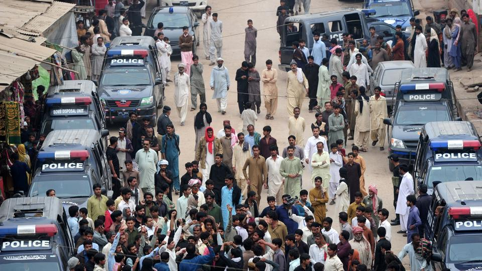 Pakistani devotees shout slogans against the bomb attack on the shrine of 13th century Muslim Sufi saint Lal Shahbaz Qalandar,in Karachi.