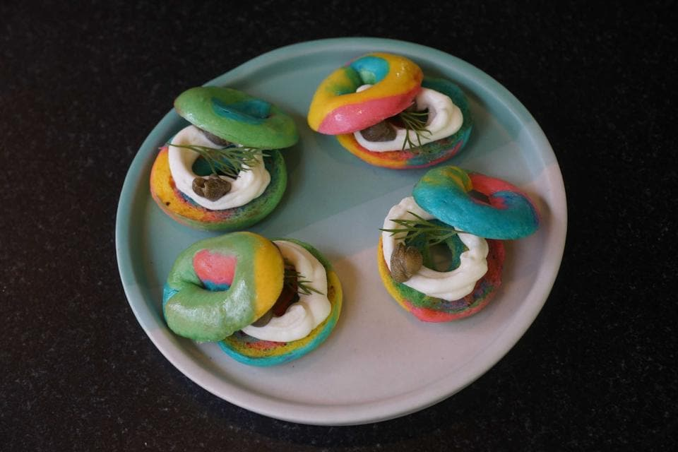 A plate of bite-sized, Instagram-friendly rainbow bagel amuse-bouches are presented immediately after we place our order. Chewy and firm with a filling of cream cheese and olives, they're an amusing start to the meal.