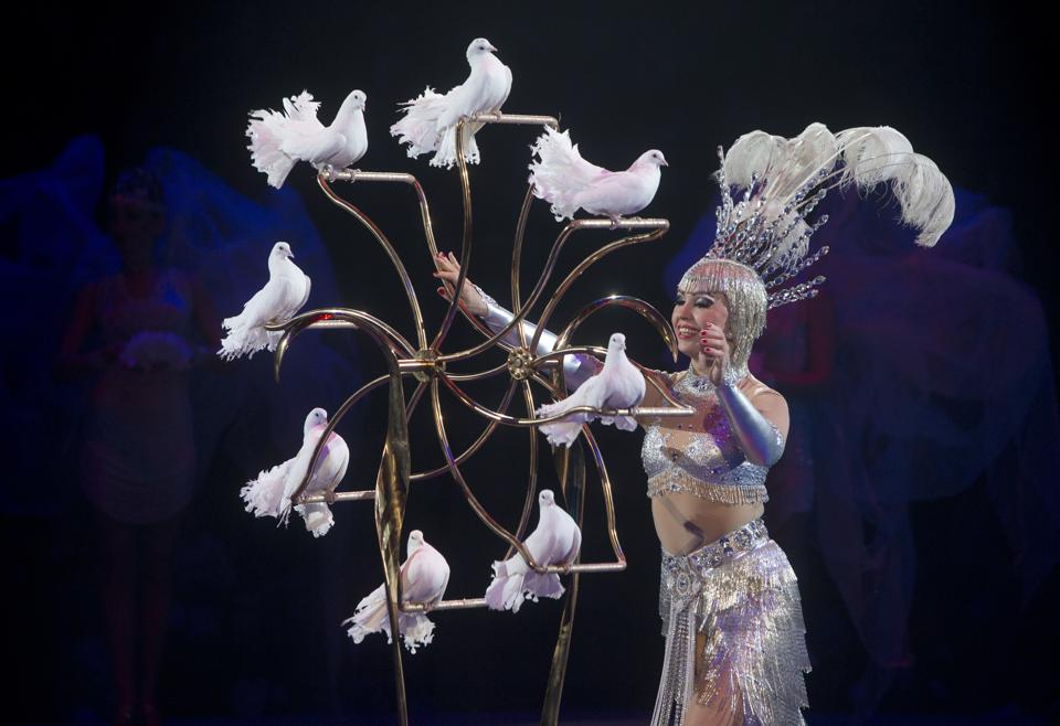 An artist performs with white pigeons at a new circus show in Kiev. (Efrem Lukatsky/AP)