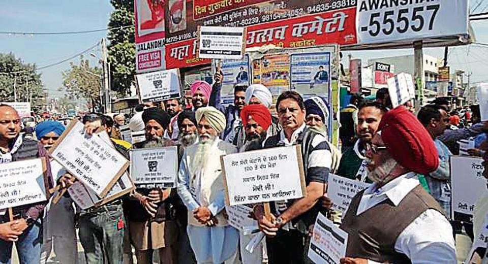 APP members protesting against the central government in Nakodar on Saturday.