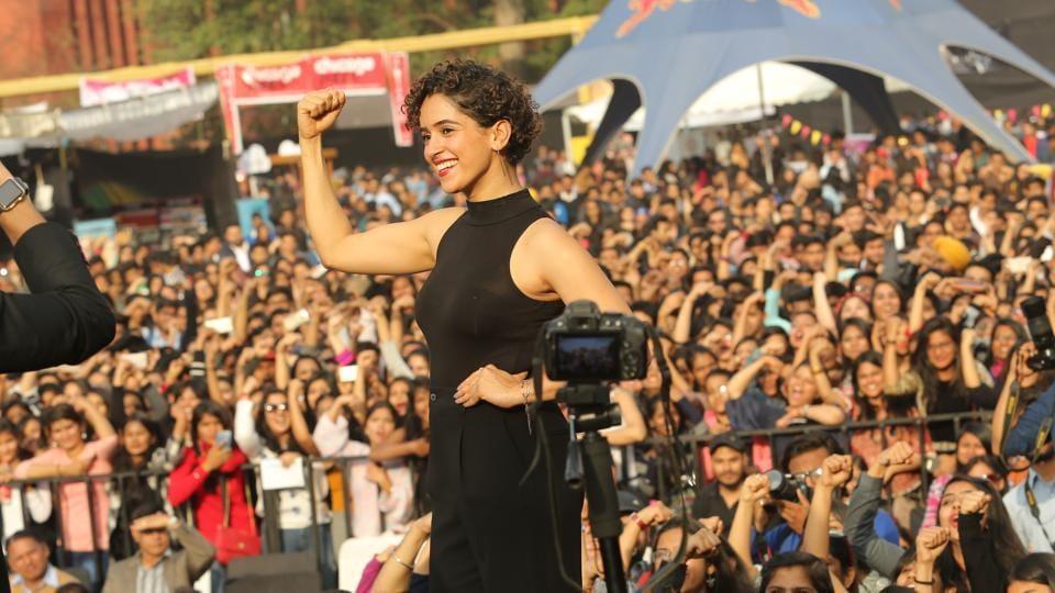 Sanya Malhotra posing onstage at the fest.