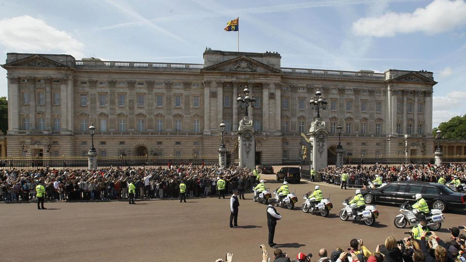 In this file photo dated Tuesday, May 24, 2011, The Royal Standard flag flies from above Buckingham Palace in London as the convoy carrying US President Barack Obama arrives.
