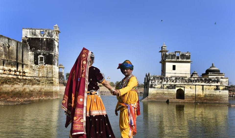 Tourists pose outside Rani Padmini Palace in Chittorgarh. The palace is popularly believed to be the place where Alauddin Khilji had a a glimpse of the beautiful queen Padmini's reflection