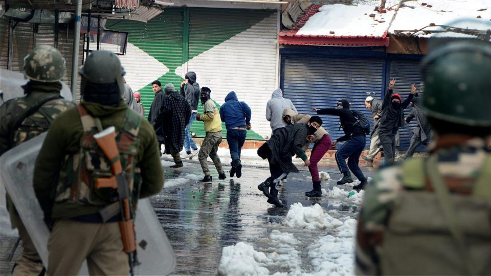Youth pelting stones at security personnel during clashes that erupted in Srinagar.