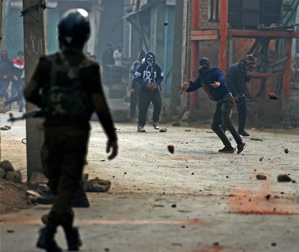 Police chasing away stone pelters during a clash at Batmaloo in central Srinagar.