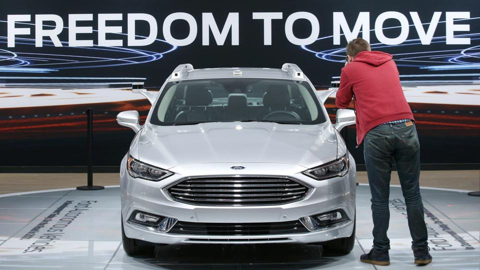 A Ford Fusion Titanium Hybrid autonomous car is displayed during the North American International Auto Show in Detroit, Michigan.