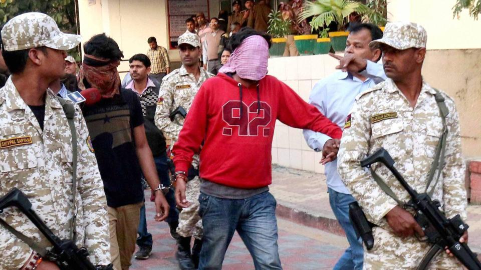 Officials of the Madhya Pradesh Anti-Terrorism Squad escort members of the spying ring to the Bhopal district court.