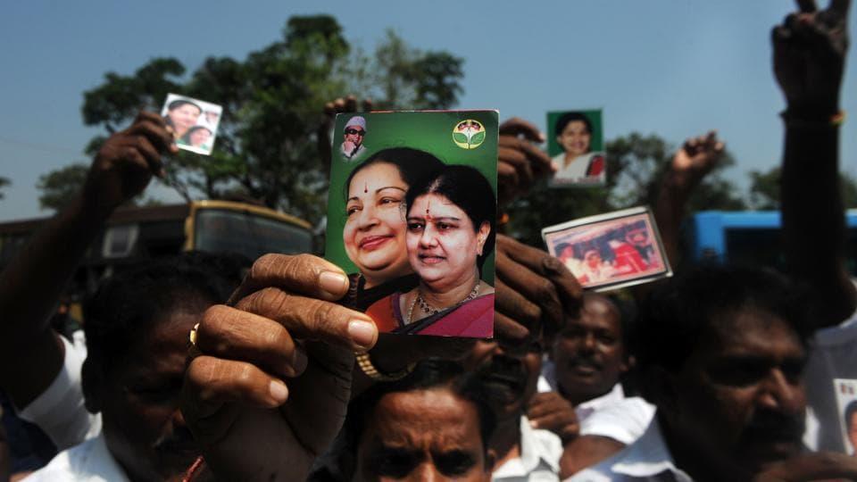Members of the AIADMK party display portraits of VK Sasikala and former Tamil Nadu CMJJayalalithaa, in Chennai on February 16.
