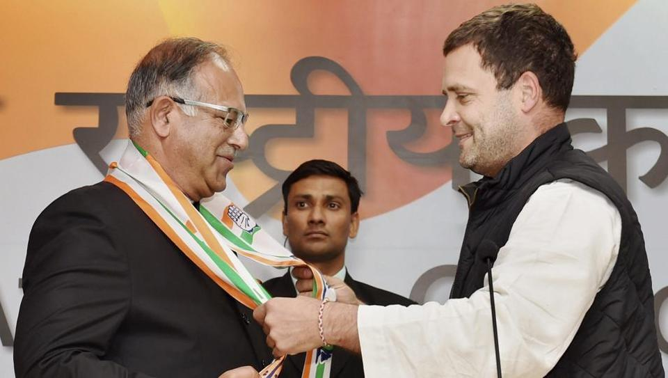 Congress vice president Rahul Gandhi welcomes former Lok Sabha member of PDP Tariq Hameed Karra in to the Congress at the AICC Headquarters in New Delhi on Saturday.
