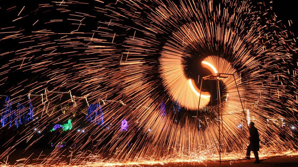 A folk artist performs the art of making shower of melted iron sparks at an event celebrating the Lantern Festival in Anyang, Henan province in China on February 11, 2017.  (REUTERS)