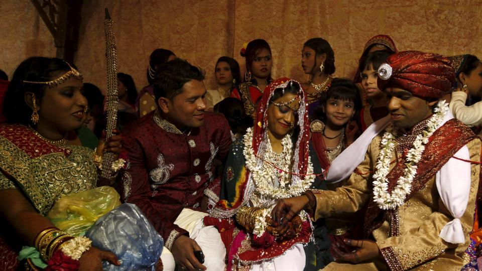 A Hindu bride and groom go through a ritual during a mass marriage ceremony in Karachi, Pakistan, in January 2016.