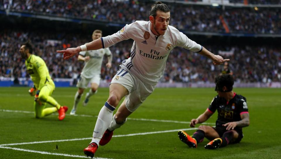 Real Madrid's Gareth Bale celebrates after scoring against Espanyol during their Spanish La Liga match at the Santiago Bernabeu stadium in Madrid on Saturday.