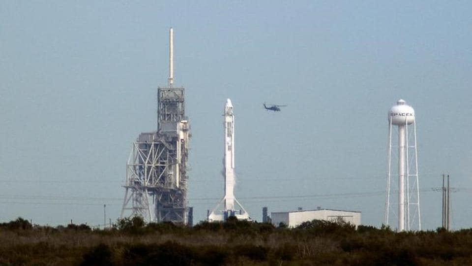 A SpaceX Falcon 9 rocket sits on the launch pad after being scrubbed due to a technical problem.