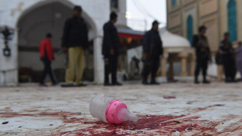 Pakistani security personnel stand guard at the Sufi shrine of Lal  Shahbaz Qalandar a day after a bomb attack in the town of Sehwan in Sindh province on February 17, 2017.