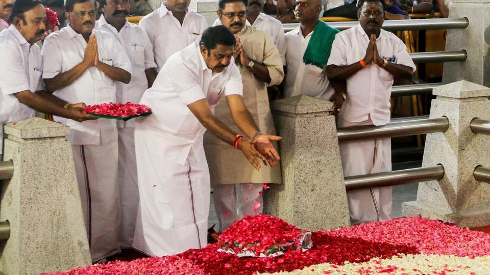 Tamil Nadu chief minister Edappadi K Palaniswami offers floral tributes at late J Jayalalithaa's memorial at the Marina beach in Chennai.
