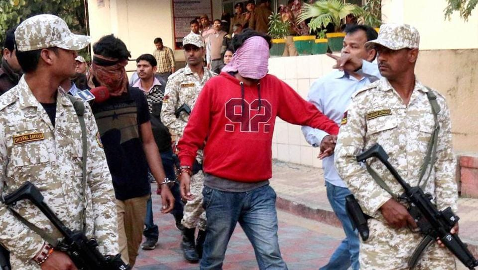 Anti-Terrorist Squad (ATS) of Madhya Pradesh police take suspected members of the Pakistani spy ring to a district court in Bhopal.