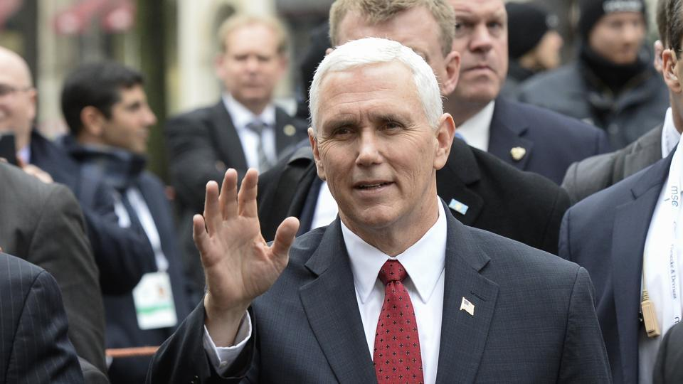US vice president Michael Richard Pence waves on his way to bilateral talks at the 53rd Munich Security Conference (MSC) at the Bayerischer Hof hotel in Munich, southern Germany, on February 18.