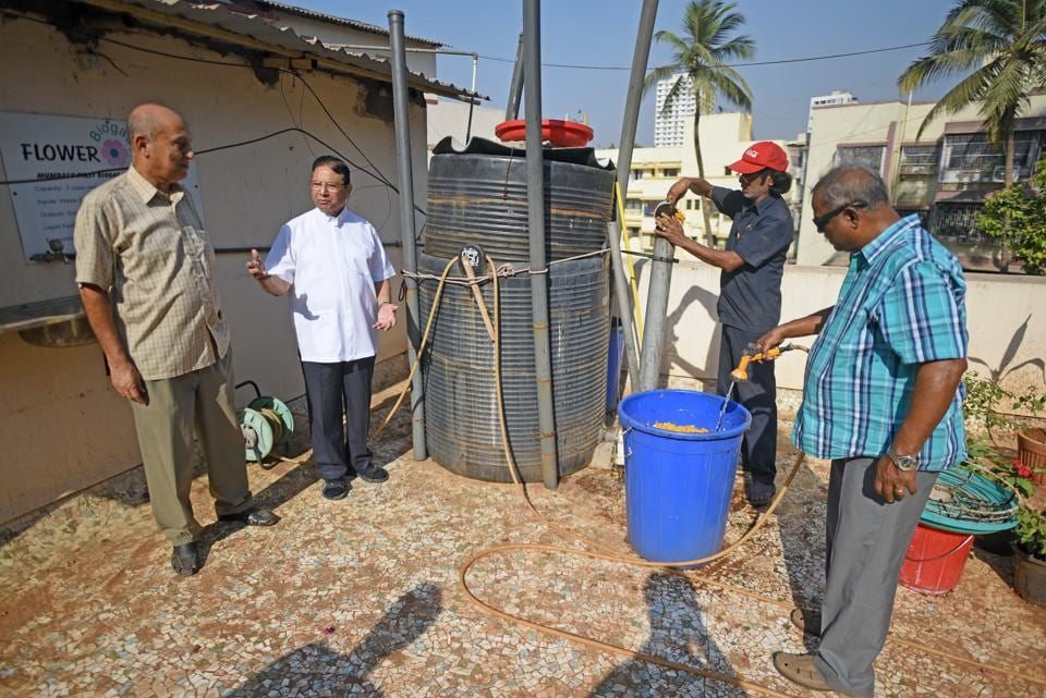 Authorities of t Michael's church in Mahim explain the functioning of the biogas plant.