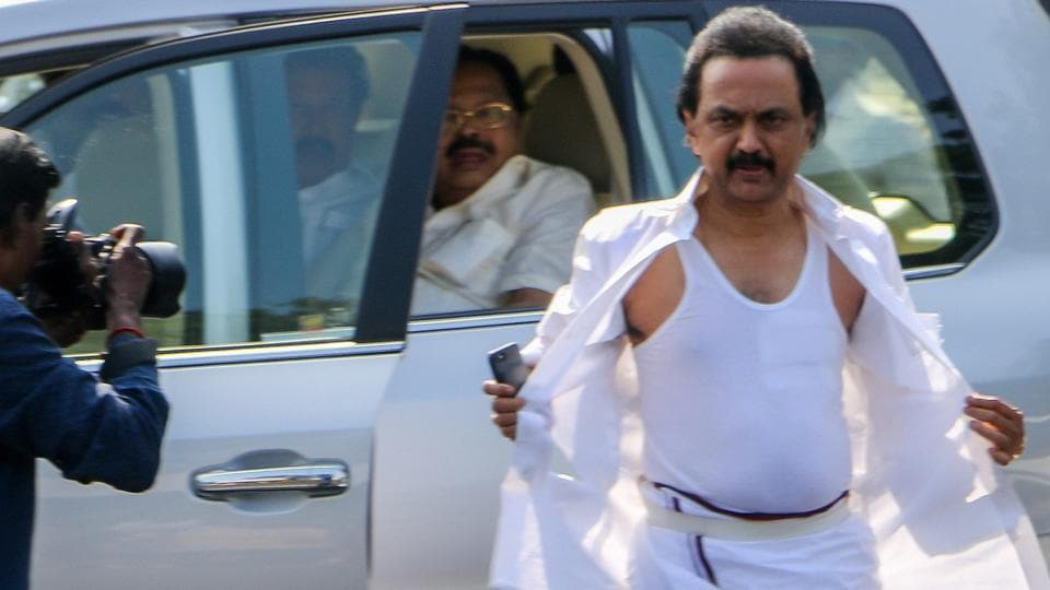 MK Stalin displays his torn shirt after the ruckus during the confidence vote, outside Fort St George in Chennai.