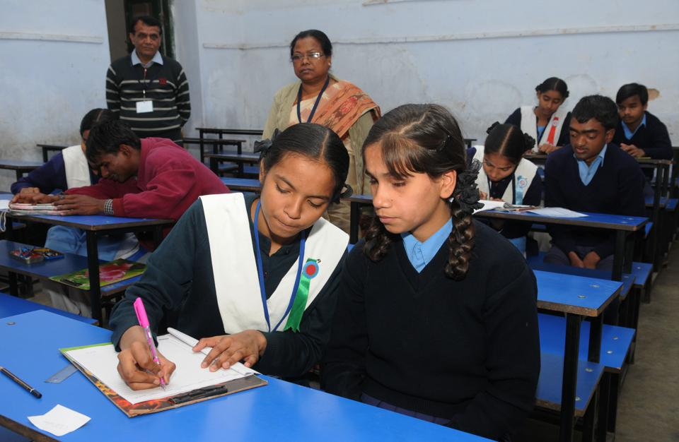Visually challenged students appearing in the matriculation examination with help of a writer  at St Margaret school centre in Ranchi, India, on Saturday