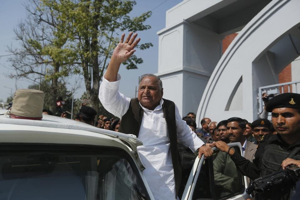 Samajwadi Party leader Mulayam Singh Yadav waves to supporters after casting his vote at a polling station in Saifai, in Etawah, Uttar Pradesh on Feb 19.