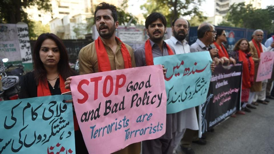 Pakistani civil society activists take part in a protest for peace in Karachi on February 18, 2017, following a deadly bomb attack on the shrine of 13th century Muslim Sufi saint Lal Shahbaz Qalandar in the town of Sehwan.