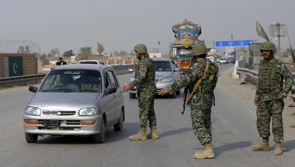 Pakistani paramilitary soldiers stop a vehicle at a security check point in Peshawar on February 17, following bomb attack on a shrine of 13th century Muslim Sufi saint Lal Shahbaz Qalandar in the town of Sehwan in Sindh province.
