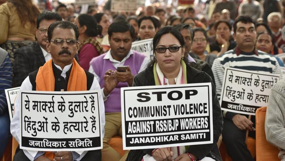 Workers protest against attacks on RSS, BJP workers in Kerala, at Kerala Bhavan in New Delhi.