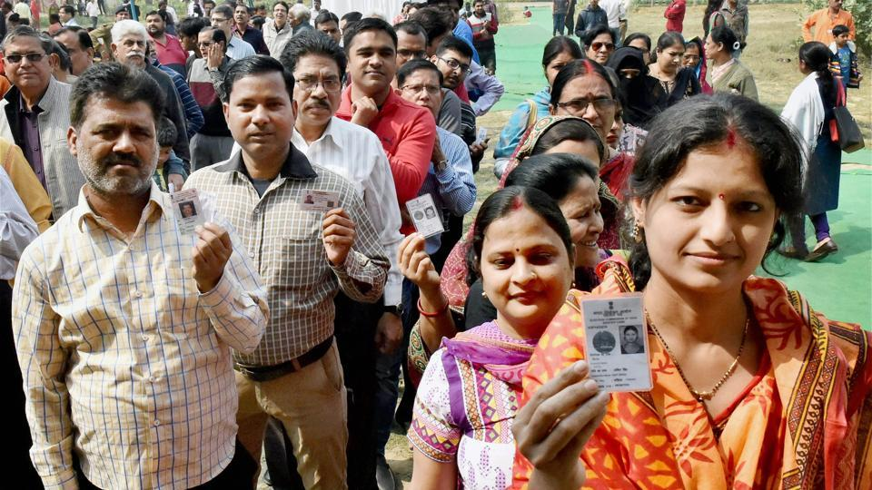 Voters queue up to cast their votes during the third phase of the UP assembly elections in Lucknow on Sunday.