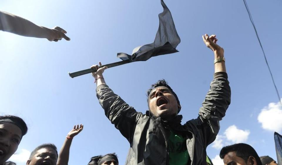 Nepalese activists from the Federal Alliance (members of the Madhesi and ethnic communities) chant anti-constitution slogans on the first anniversary of Nepal's new constitution in Kathmandu on September 19.