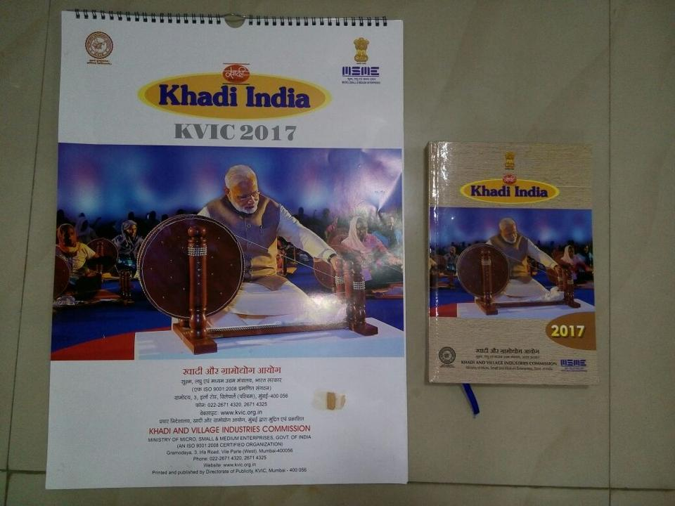 The PM's photograph -- which was published on the cover pages of the KVIC 2017 calendar and diary -- shows Modi weaving on a large charkha, in the same classic pose as Mahatma Gandhi.