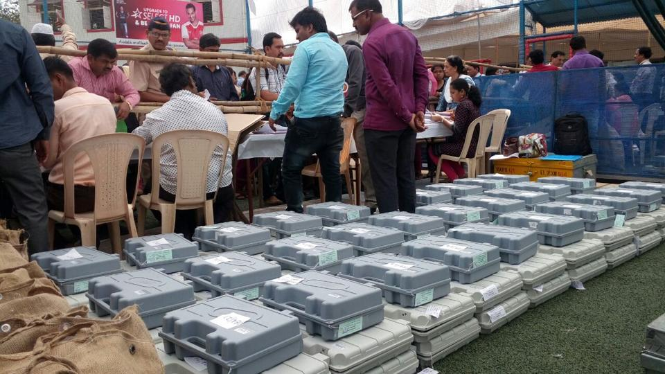 FALL IN LINE: EVMs lined up at a school in Dadar. (ANSHUMAN POYREKAR/HT)