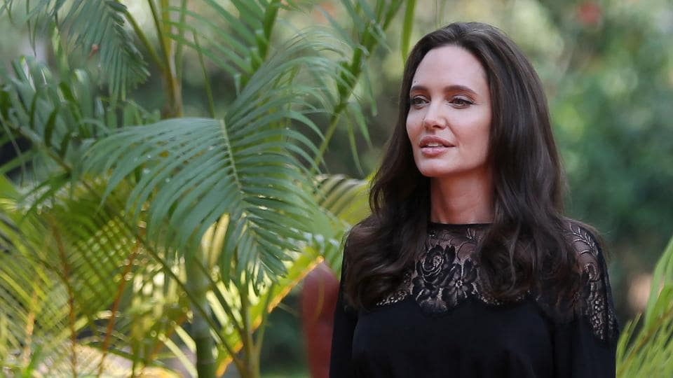 Actor Angelina Jolie arrives for a news conference at a hotel in Siem Reap province, Cambodia.