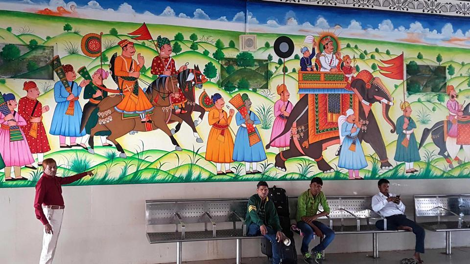 Mohammad Lukman shows his paintings at a waiting room in Kota Railway station.