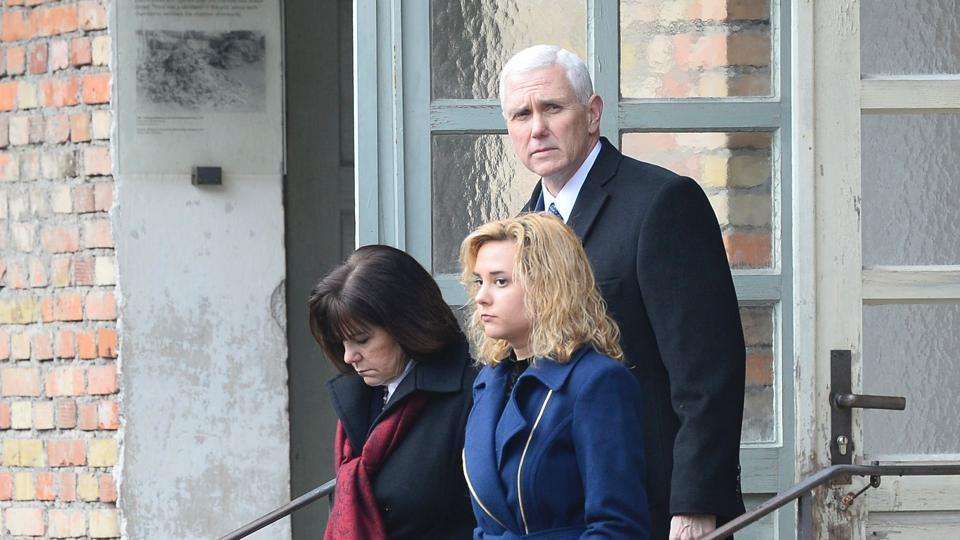 US Vice President Michael Richard Pence (R), his wife Karen Pence (L) and his daughter Charlotte Pence react as they leave the former disinfection chambers at the Dachau Concentration Camp Memorial Site at the former Nazi concentration camp of Dachau, southwestern Germany, on February 19.