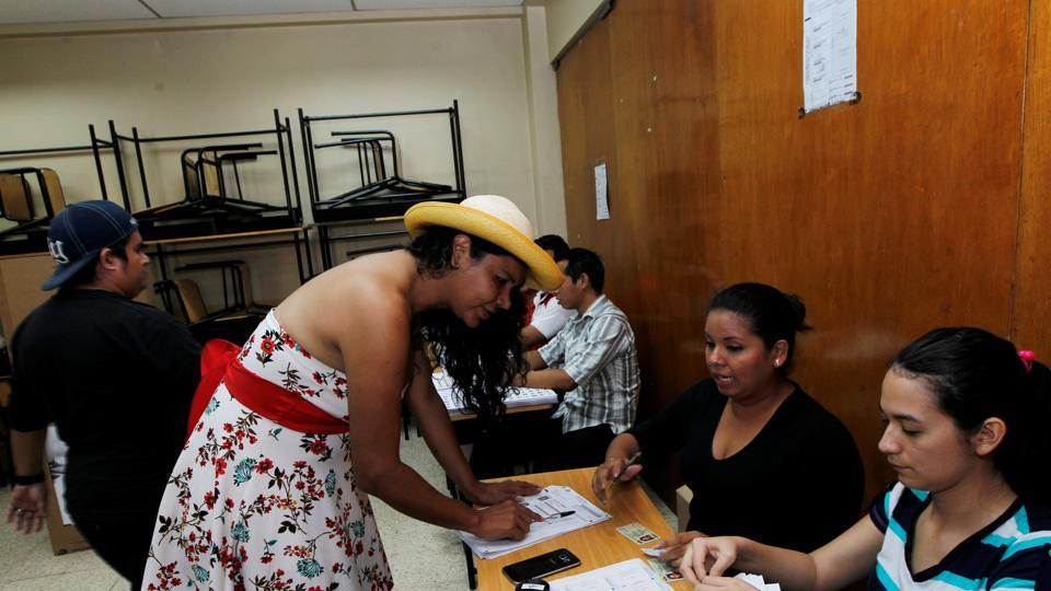 Diane Rodriguez, a member of the Ecuadorean transgender community, registers before casting her vote during the presidential election in Guayaqui on Sunday.