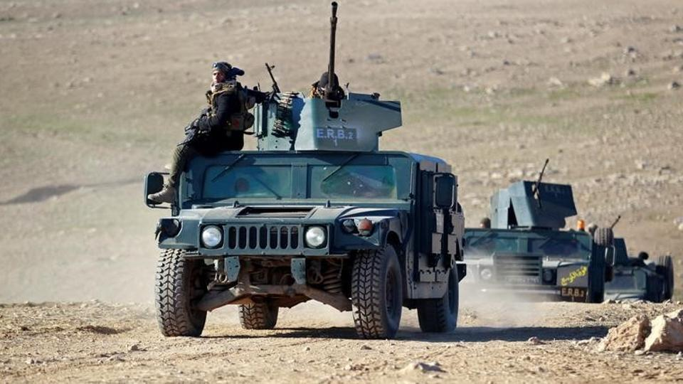 Iraqi security forces advance towards the south of Mosul, Iraq, on February 19.