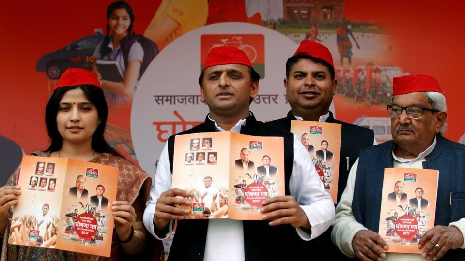 Uttar Pradesh chief minister Akhilesh Yadav (C) poses for media at the release of the party's manifesto in Lucknow on January 22.