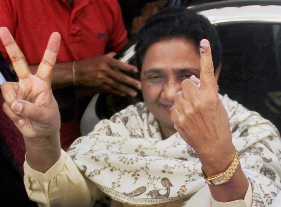 BSP supremo Mayawati flashes the victory sign and shows her inked finger after casting her vote in Lucknow on Sunday.