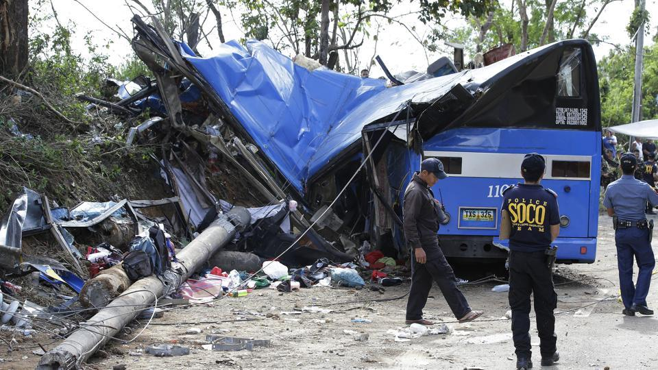 At least 14 killed in Philippine bus crash