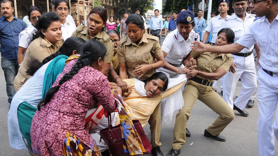 Activists protesting against the child trafficking racket clash with police in Kolkata in November.