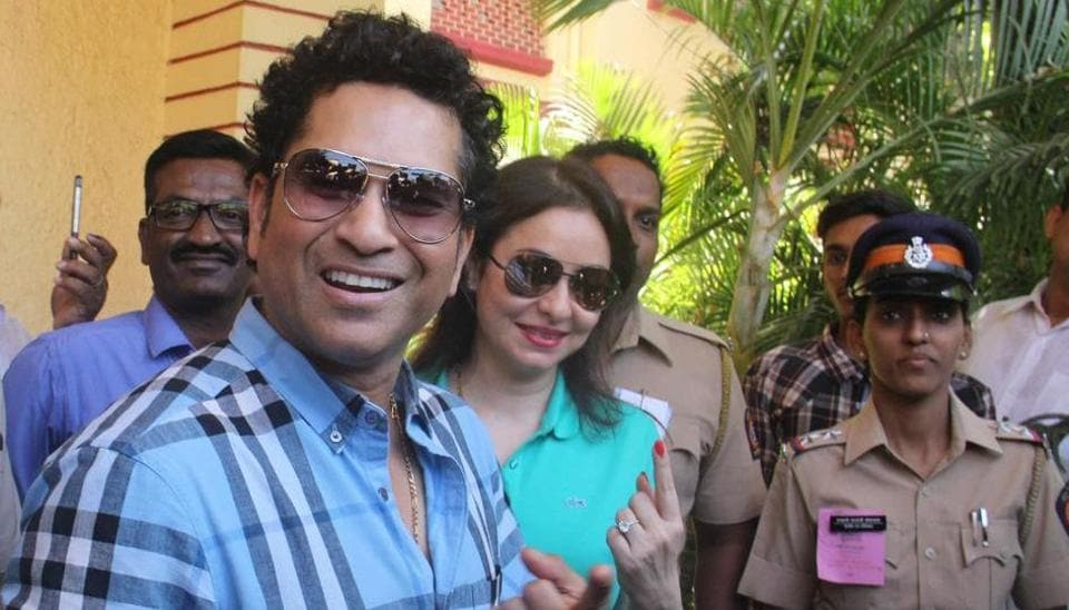 Cricketer Sachin Tendulkar outside a polling booth in Bandra after casting his vote.