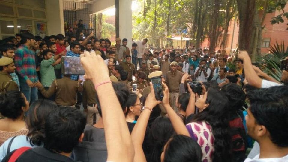 ABVP activists and students of Ramjas college clash outside the  auditorium on campus on February 21, 2017.