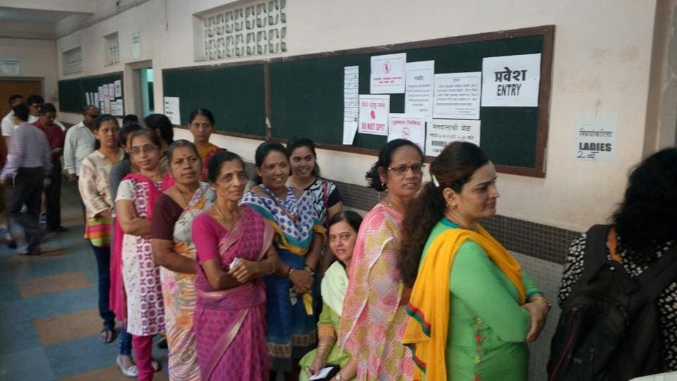Voters at a polling booth in Prabhadevi.