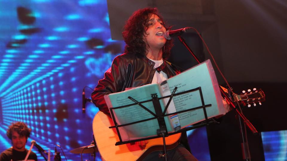 Singer Nikhil D'Souza performing on stage at Symbiosis Law School's annual cultural fest, Symfiesta.