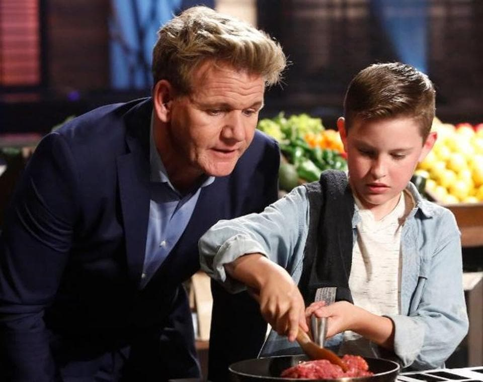 Gordon Ramsay with a contestant on the sets of MasterChef Junior.
